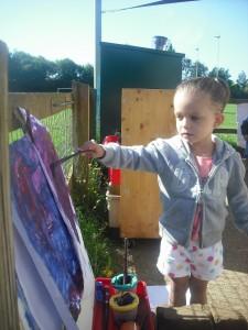 Girl Painting At Nursery